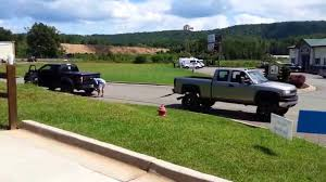Tug-of-War Ford Raptor Vs. Chevy Duramax! | Muscle Horsepower