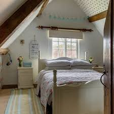 Eaves Bedroom With Slanted Ceiling On Both Sides