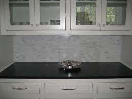 gray brick backsplash glass front cabinets glass knobs marble mini
