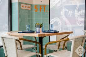 The Interior Features A Large Bar Private Dining Hall Raw And Several Different Rooms Blue Orange Teal Color Scheme