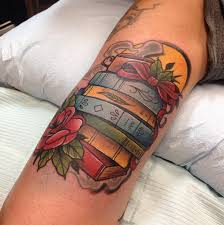 Depiction Tattoo Gallery Tattoos Flower Stack Of Books