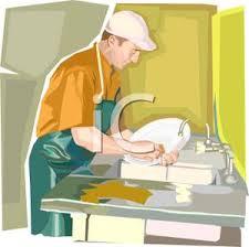 Dishwasher In A Restaurant Kitchen