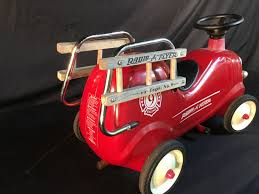 VINTAGE RADIO FLYER FIRE TRUCK RIDE ON KIDS TOY, 27'' LONG Little Tikes Spray Rescue Fire Truck Walmart Canada Rigo Kids Rideon Car Engine Pumper Motorbike Motorcycle Best Popular Avigo Ram 3500 Ride On Electric Firetruck For Toddlers Power Wheels Paw 12v Suv W 2 Speeds Lights Aux Red Fireman Sam M09281 6 V Battery Operated Jupiter Amazon 2yearolds Toys Of All Ages 12v In A Costume 18 Mths To 5 Yrs Removable Water Hose