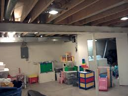 Basement Lighting For Unfinished Ideas Have Kitchen Equipment Safe In With Brick Wall Design And Decoration