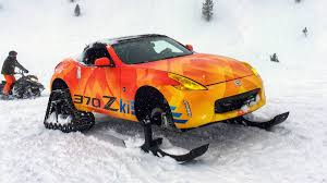Nissan Fits Skis And Snow Tracks To A 370Z Roadster For 2018 Chicago ... 4x4 Tracks For 4runners Fj Cruisers More Rubber Snow Adventure Sport Rentals 5092410232 Atv Track Over The Tire Right Systems Int Jeeprubiconwnglerlarolitedsptsnowtracksdominator John Deere Gators Get On Track American Truck Announces That South Dakota Police Department Farm Show Magazine Best Stories About Madeitmyself Shop Fifteen Cars Ditched Tires Autotraderca Mattracks Cversions Gmc Unveils Sierra 2500hd All Mountain A Denali With Tracks Custom You Can Buy The Snocat Dodge Ram From Diesel Brothers