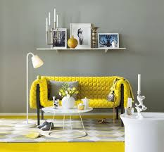 Table In Yellow Grey Living Room Near Long White Shelf On