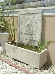 Potanico Contemporary Outdoor Garden Waterfall Feature Alongside Squared Shape With Outline And Mosaic Decorations