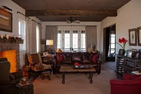 White Farmhouse Living Room Boasts Cozy Furnishings