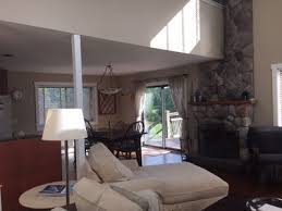 Living Room With Fireplace In The Middle by On The River Sunlit Filled Country Home Homeaway New Paltz