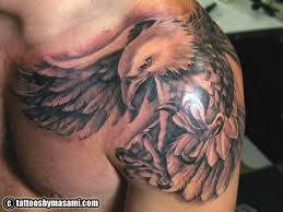 Black And Grey Flying Eagle Tattoo On Man Left Shoulder