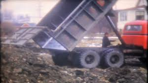 1595 - Dump Truck Driver Drops His Load Of Dirt At The Job Site ...