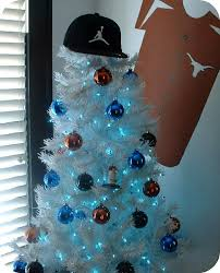 So Their Baseball Tree Is White With Blue Lights And Ornaments A Few Orange Black Balls For