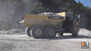100 Midwest Truck Equipment Komatsu HM300 Articulated In Quarry Application Lime