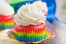 Rainbow Cupcakes With Fluffy Cloud Like Vanilla Frosting That Is Guaranteed To Make Anyone Who