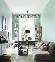Small Rectangular Living Room Layout by Narrow Living Room With Desk And Bookshelves At The Window
