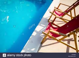 100 Marine Folding Deck Chairs Chairs At Side Of Pool Stock Photo 211104130 Alamy