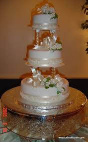 Love the clear columns needs purple ribbon and more icing flowers