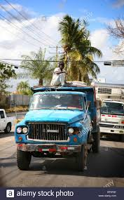 Man Sat On Top Of A Truck Driving Down The Highway In Dominican ... Illustration Of A Side And Top View Pickup Truck Royalty Free How To Remove A Trucks Hard Shell Top Or Camper Cheap And Easy Newquay Cornwall Uk April 7 2017 Female Rnli Lifeguard Keeping 8 Custom Accsories You Need Tsa Car Fileman On Of Truck Stacked With Bags Wool Am 869111 Want The Best Resale Value Buy Pro Psbattle This Dog Ptoshopbattles Convert Your Into Camper 6 Steps Pictures 10 Benefits Owning Rv Lifestyle News Tips Overpass Fell Wtf