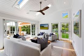 Bright Window Living Room With Skylights And Maple Wood Floors