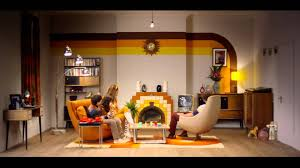 a time lapse of a living room evolving from the advent of
