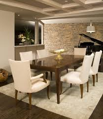 Modern Dining Room With Clean Lines And Neutral Stone Wall On In