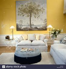 large 18th century style picture above pale gray sofa in pale