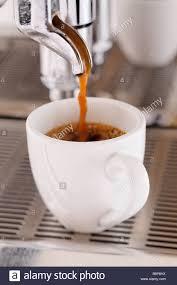 Espresso Machine Pouring Coffee Into Cup