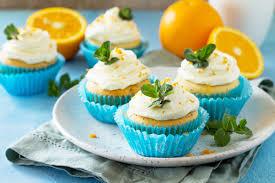 orangen cupcakes mit frosting und lemon curd