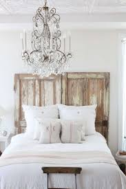 BedroomElegant Scandinavian Bedroom Decor With Rustic Wood Headboard Also Chic Crystal Chandelier White