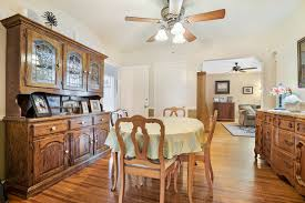 Formal Dining Room With Hardwood Floors And Ceiling Fan View Into The Living