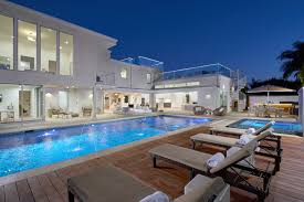 100 Beach Houses In La Modern Newport Home With Pool Natural Light Rooftop Decks Pool And Fire Pits