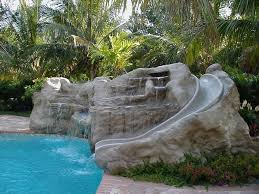 Inspiring Custom Pool Design With Water Slide On Big Natural Rock Fountain And Scenic