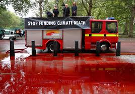100 Fire Truck Red Climate Change Activists Hose Fake Blood At UK Treasury