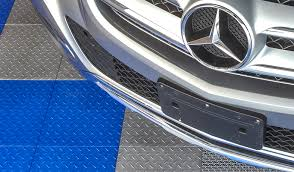 Foam Tile Flooring With Diamond Plate Texture by Garage Floor Tile Project Before U0026 After