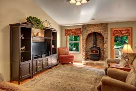 rustic living room with built in bookshelf ceiling fan in
