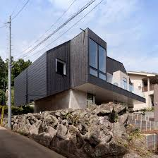 100 House Architect Design Cubo Pairs Blackened Wood With Concrete For