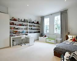 Large Trendy Boy Carpeted Kids Bedroom Photo In London With White Walls