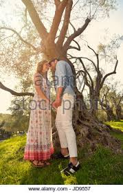 couple relax under the tree Fine art style Olive garden Stock