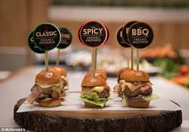 Mini Burgers With Thick Patties Served In Brioche Buns And Delicate Chicken Morsels On Melba