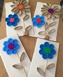 Craft Ideas For Kids Four Pieces Of Carboard Decorated With Flowers Made From Used