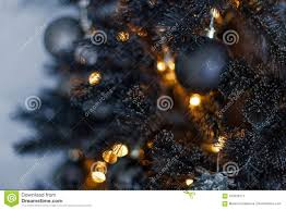 Christmas Dark Blurred Background With A Black Tree Ornaments And Bokeh Lights