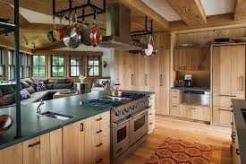 Island Range Hood With Hanging Pan Over Cooktop Black Quartz Countertop In Contemporary Kitchen Ideas