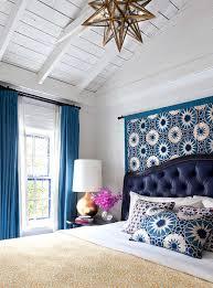 Blue Mediterranean Bedroom with Blue Starburst Tapestry Behind