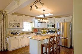 santa cecilia granite with white cabinets indelink