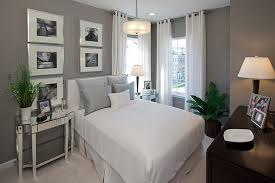 Grey Wall Decor And Comfy Beds In Small Bedrooms