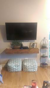 mounte tv with shelf under Google Search
