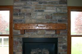 Stone Fireplace Mantel | Weatherwax Construction Hand Hune Barn Beam Mantel Funk Junk Relieving Rustic Fireplace Also Made From A Hewn Champaign Il Pure Barn Beam Fireplace Mantel Mantels Wood Lakeside Cabinets And Woodworking Custom Mantle Reclaimed Hand Hewn Beams Reclaimed Real Antique Demstration Day Using Barnwood Beams Img_1507 2 My Ideal Home Pinterest Door Patina Farm Update Stone Mantels Velvet Linen