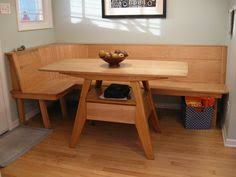 Simple Table Set In Kitchen With Light Brown Rectangular Dining Plain Wooden Corner Bench And Black White Canvas Panting Frame
