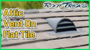 attic vent on flat tile roof
