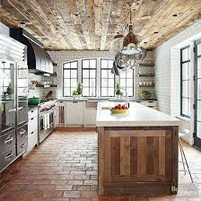 Rustic Wood Planked Ceilings Brick Floors Modern Kitchen Appliances And White Subway Tile Walls Surrounding A Beautiful Arched Window